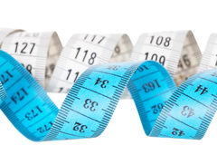 White and blue measuring tapes Royalty Free Stock Images