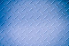 White and blue metal diamond plate wall texture background. A White and blue metal diamond plate wall texture background royalty free stock images