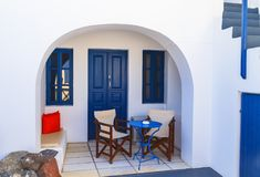 White-blue national greek architecture on Santorini island, Greece. hotel entrance with blue windows in Fira stock photo