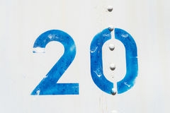 White blue number 20 old metal background texture. White blue number 20 twenty background texture from an old metal train car Royalty Free Stock Photo