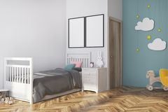 Blue nursery interior, armchair and posters side. White and blue nursery corner with a gray bed, a yellow armchair, cloud decoration and two vertical posters. 3d Stock Photo