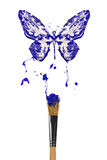 White and blue painted butterfly hover above bursting blue paint Royalty Free Stock Photos