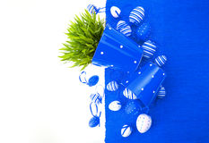 White blue painted easter eggs with green grass Royalty Free Stock Photography