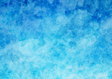 White and Blue Parchment Paper Texture Background. Blue and white hand-painted clouds on parchment paper with visible brush strokes, background texture wallpaper Royalty Free Stock Photo