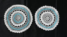 White and Blue pattern crochet tablecloth Royalty Free Stock Photography