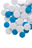 White and blue pills Stock Photo