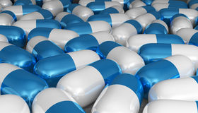 White and blue pills Stock Images