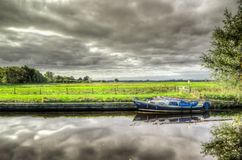 White and Blue Power Boat on Body of Water Under Clouds Royalty Free Stock Photography