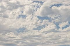 Blanket of puffy white clouds Stock Image