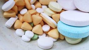 White Blue and Purple Multi Shape Medicine Pills Stock Images