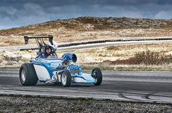 White blue racing car with a driver Stock Photos