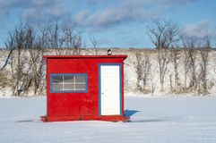 White Blue Red Ice Fishing Cabin Royalty Free Stock Photo