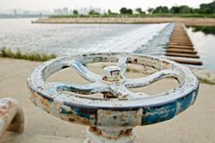 White and blue rusty faucet wheel Stock Photography