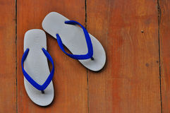 White and blue sandals. On the wood floor, Thailand, Asia royalty free stock photos