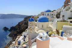White and blue of Santorini, Oia village over Aegean sea. Oia, Santorini, a Greek island with typical white buildings with blue roofs and windows royalty free stock photo