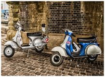 White and Blue Scooter Motorcycles Royalty Free Stock Image