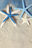 White and blue sea stars on sand Stock Photo