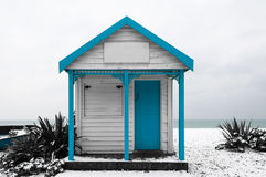 White and blue shed. On a snow covered beach Royalty Free Stock Photo