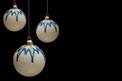 White-blue shiny Christmas balls on a black back Royalty Free Stock Photography