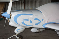 White and blue small airplane Stock Images