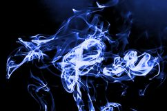 White and blue smoke. The White and blue of smoke with lighting Stock Photos