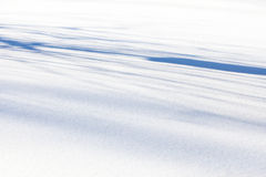 White and blue snow background. In sunshine stock images