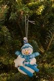 White and Blue Snowman Ornament Stock Photo