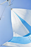 White and blue spinnaker. Spinnaker on the yacht during regata Stock Photo