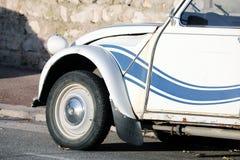 White And Blue Striped Citroen 2 CV. Roquebrune-Cap-Martin, France - December 4, 2018: White And Blue Striped Old Car Citroen 2 CV Parked On The Street, French stock photo