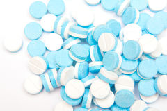 White and blue tablets pills on white background Royalty Free Stock Photos
