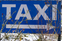 White and blue taxi sign Stock Photo