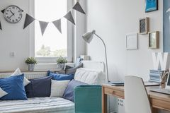 White and blue teen room. Interior of white and blue teen room royalty free stock photo