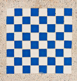 White and blue tile checkerboard. On mable floor Royalty Free Stock Images