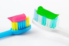 White and blue toothbrushes with toothpaste Stock Photo