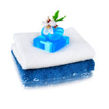 White and blue towels with blue soap Royalty Free Stock Photo