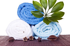 White and blue towels folded on  mat Stock Photo