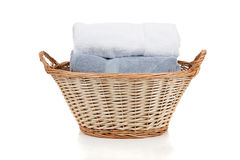 White and blue towels in a laundry basket on white Stock Images