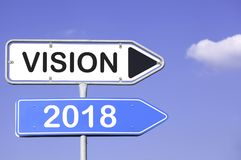 Vision 2018. White and blue traffic signs with arrows and the words vision 2018. Business concept for success turn of the year Royalty Free Stock Photography
