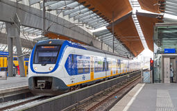White-blue train stays on Amsterdam Arena station Stock Photography