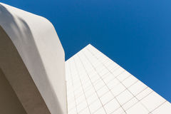 White on blue wall against sky from low point of view. Royalty Free Stock Images