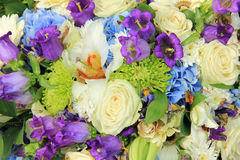 White and blue wedding bouquet. White roses and blue purple flowers in a wedding flower arrangement Royalty Free Stock Photography