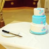 White and blue wedding cake on table Stock Images