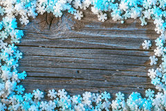 White and blue winter background with snowflakes on wooden background, christmas wallpaper Royalty Free Stock Photos
