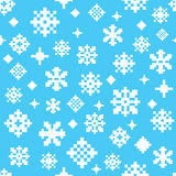 White blue winter snowflake seamless vector pattern. Made out of various pixel snowflakes Stock Image