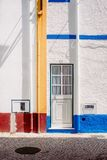 White and Blue Wooden Door and White and Blue Painted Concrete Wall Royalty Free Stock Image