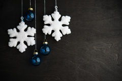 White and blue xmas ornaments on black wooden background. Merry christmas card. Winter holiday theme. Happy New Year Stock Images