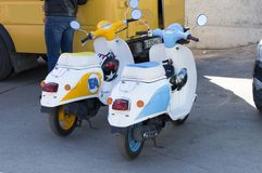 White with blue and yellow inserts scooters scooters. stock photo