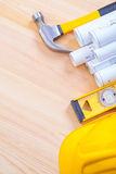White blueprints claw hammer construction level Royalty Free Stock Image
