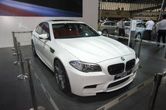 White bmw M5 four door sedan horse limited edition car Royalty Free Stock Images
