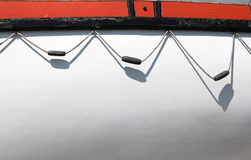 White board of boat side. White empty space on a life-boat starboard and hanging rope Stock Photos